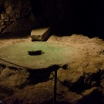 The remnants of a grain mill in a cave